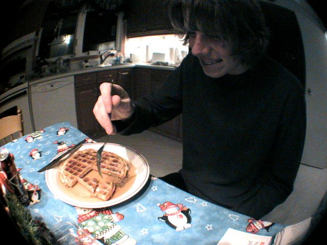 Mat eating a waffle