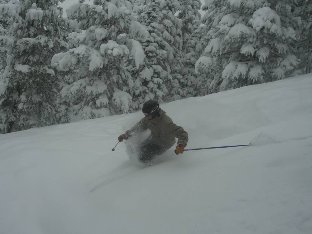 Troy skiing some pow