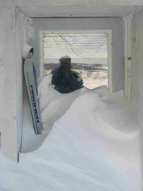 My backdoor buried in snow w/ old pair of skis.