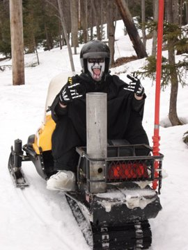 The reaper on a Snowmobile