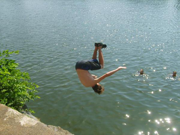 Backflip on the river. first day of summer