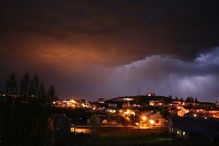 Lightning behind clouds