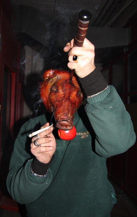 Sucking pig smokes