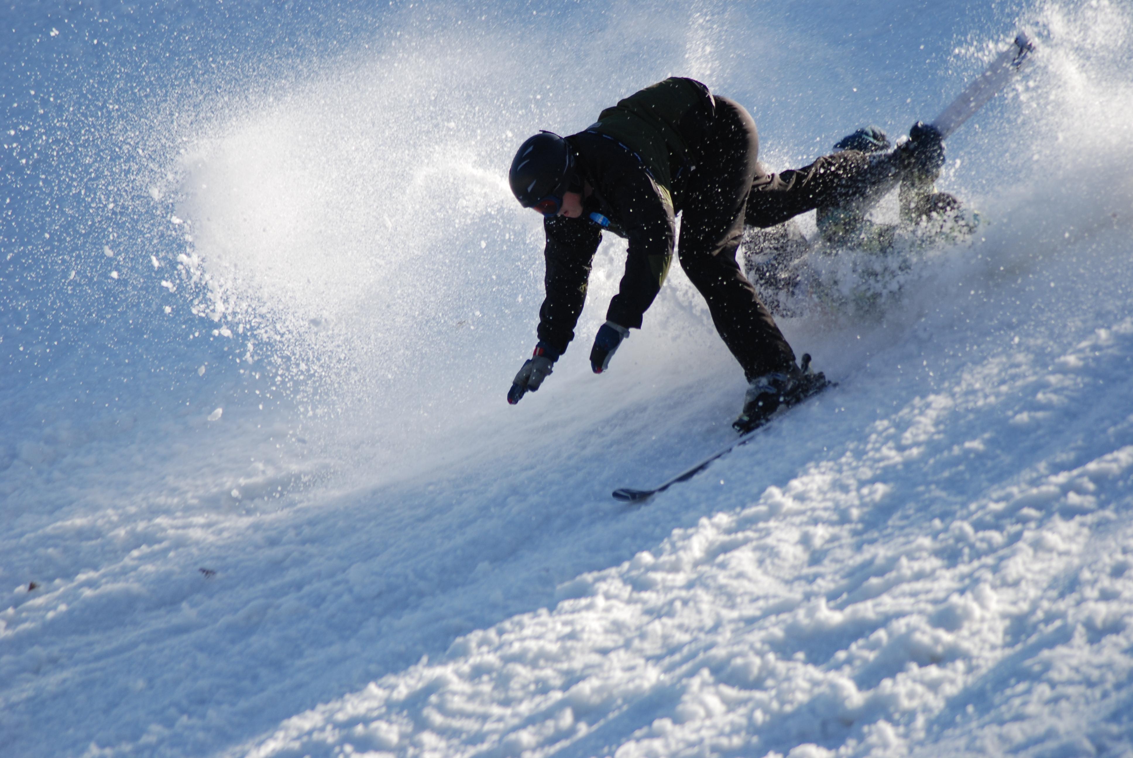 Skier and snowboarder crash