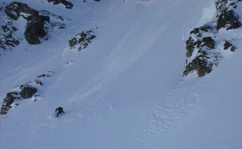 Skye Darden fakie riding in Arlberg back country