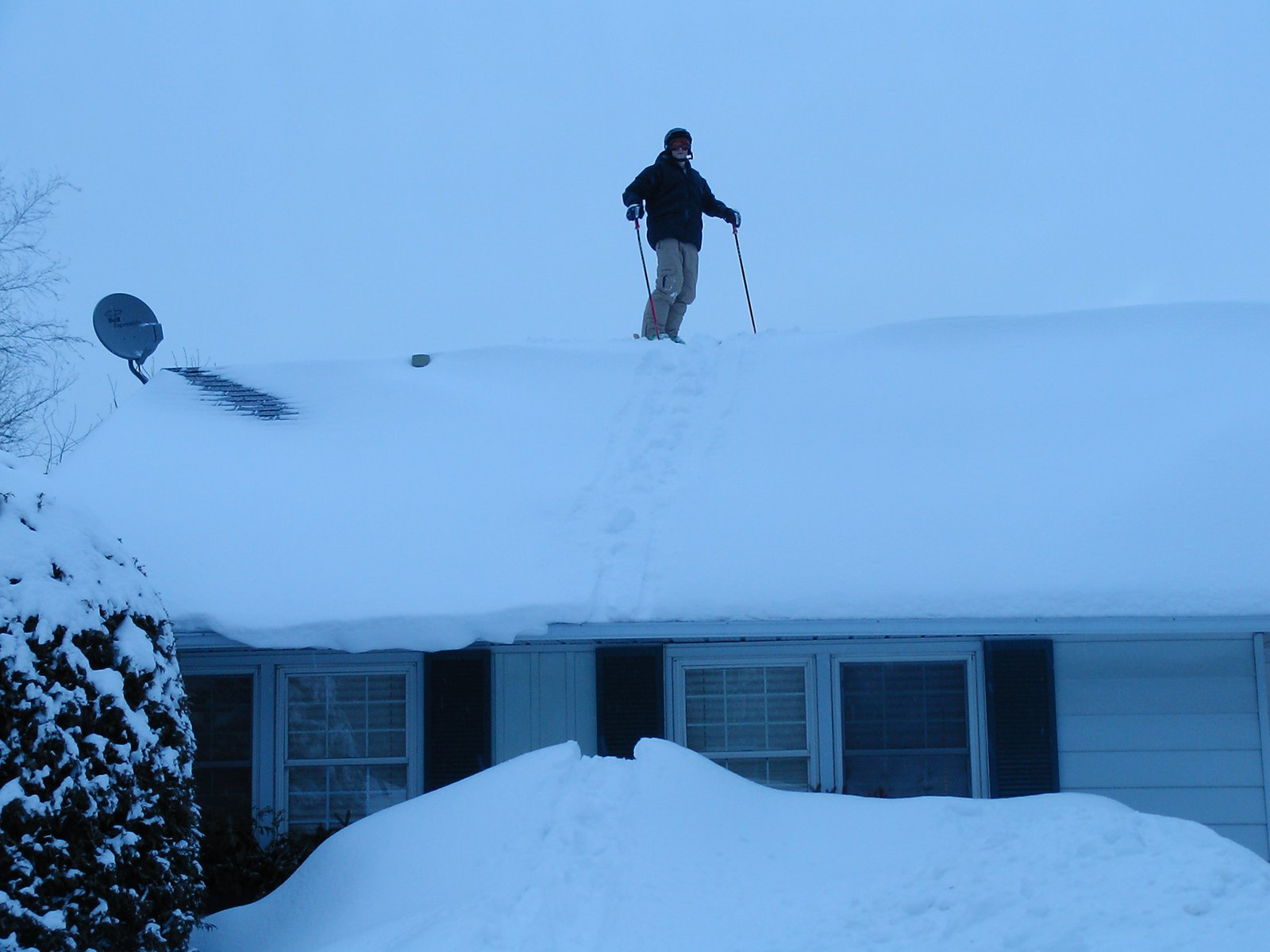 No ski hill + lotsa snow = roof skiing