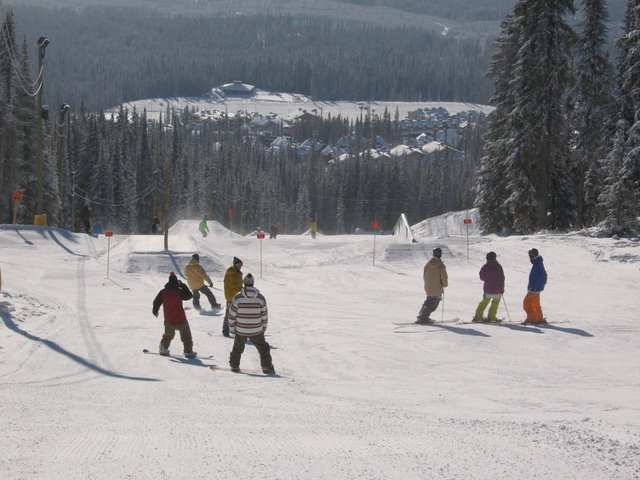 Skiers and boarders getting ready to drop in. Peace and harmony between clans!  Eh Jay.