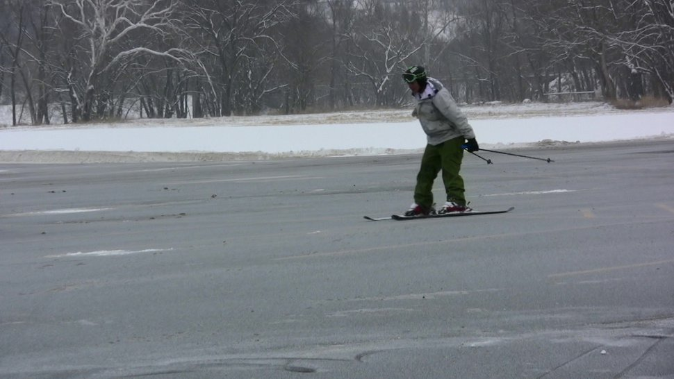 Video still: skiing in the parking lot