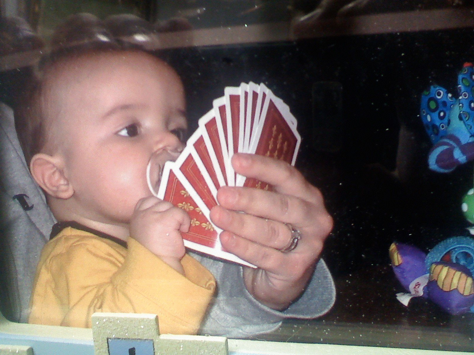 The little man already playin some cards