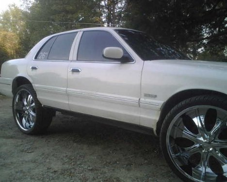 My new crown vic with 26's