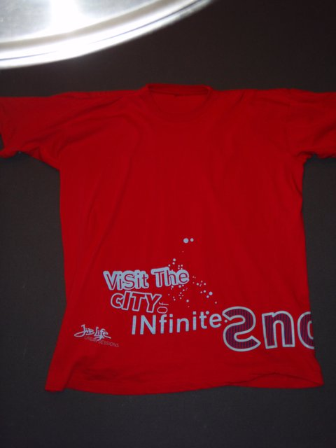 Front of red JLUS tee