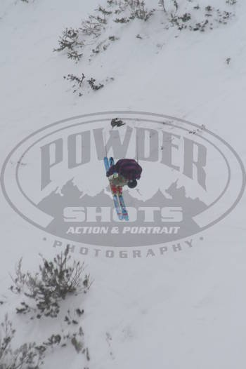 Traver Johnson busting ahuge frontflip in the Junior Freeskiing Nationals at Snowbird on Baldy