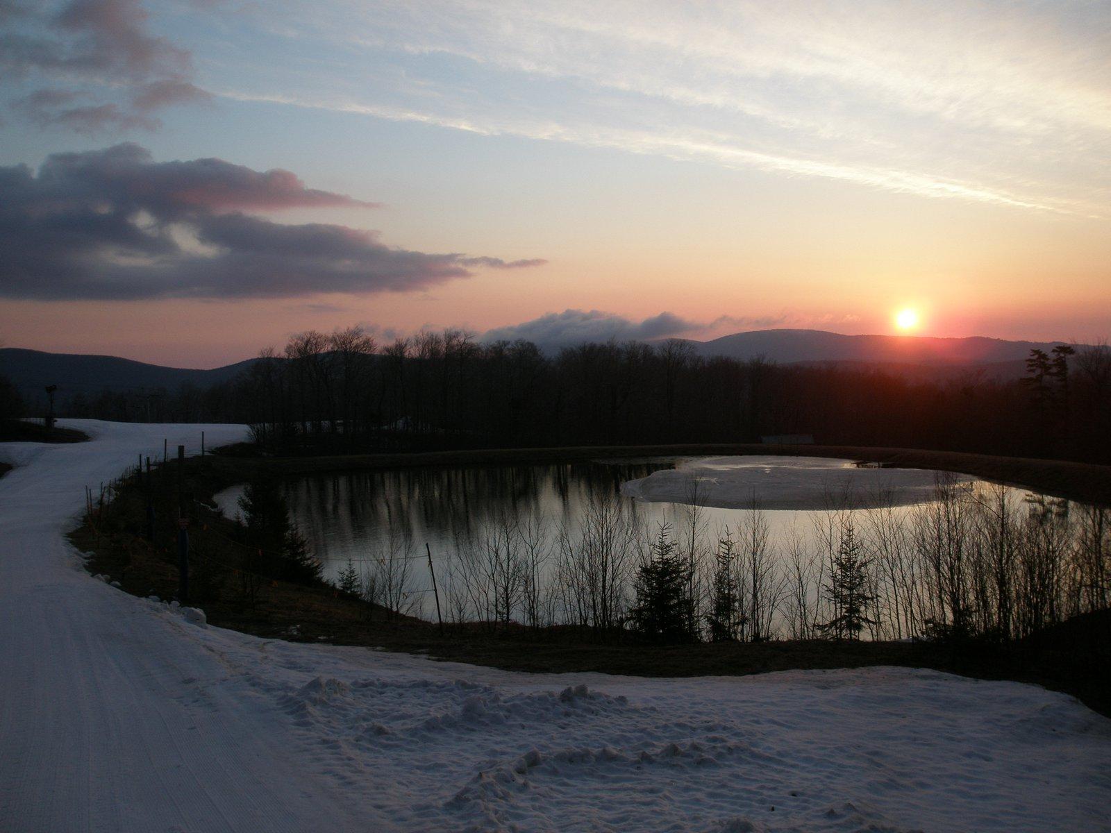 Sunrise over snowmaking pond