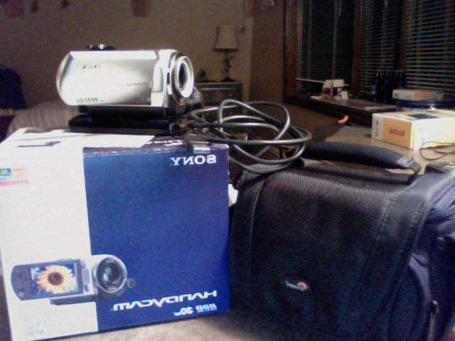 Handycam, parts, and packaging