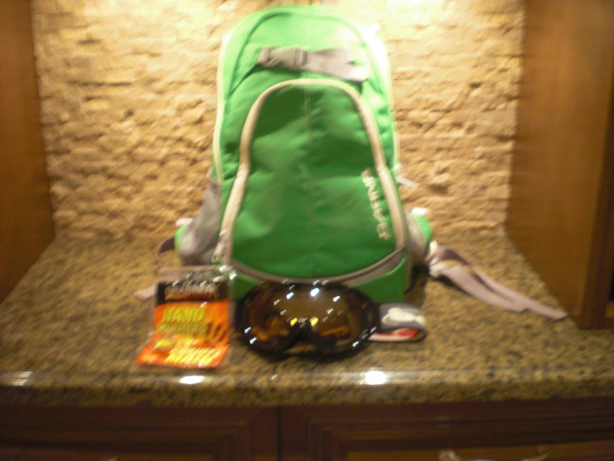 Dakine backpack, bole goggles and handwarmers