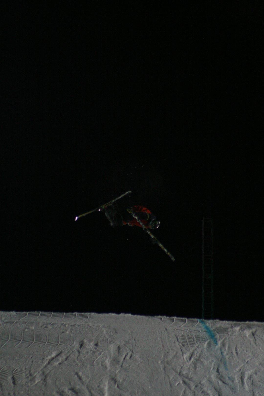 Pulling off ski mid-air.