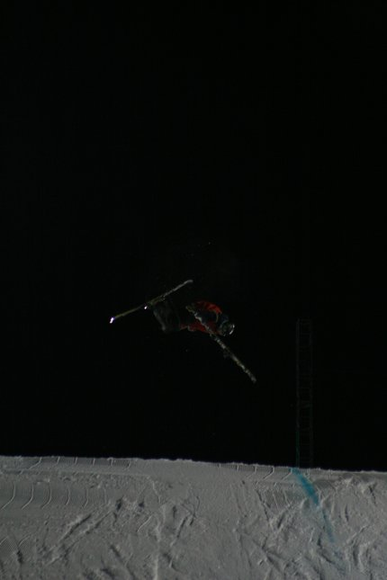 Pulling off ski mid-air.