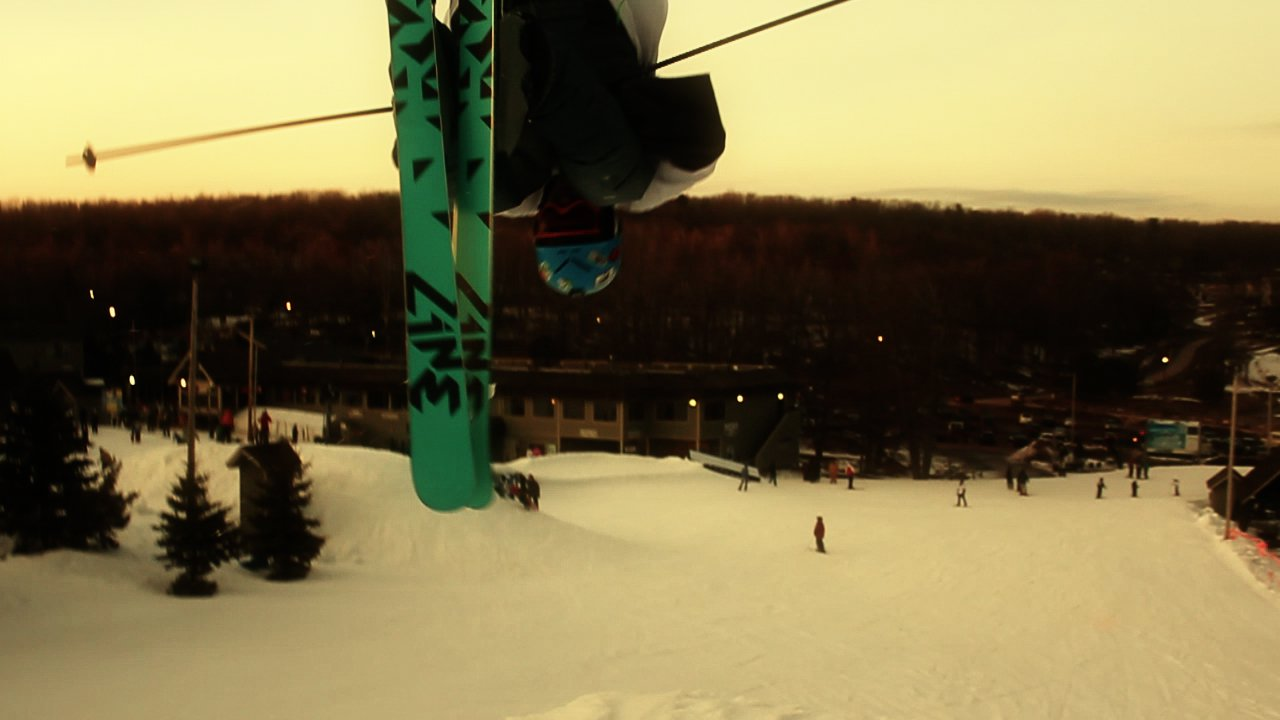 Check out my new skis, while I do a front flip.