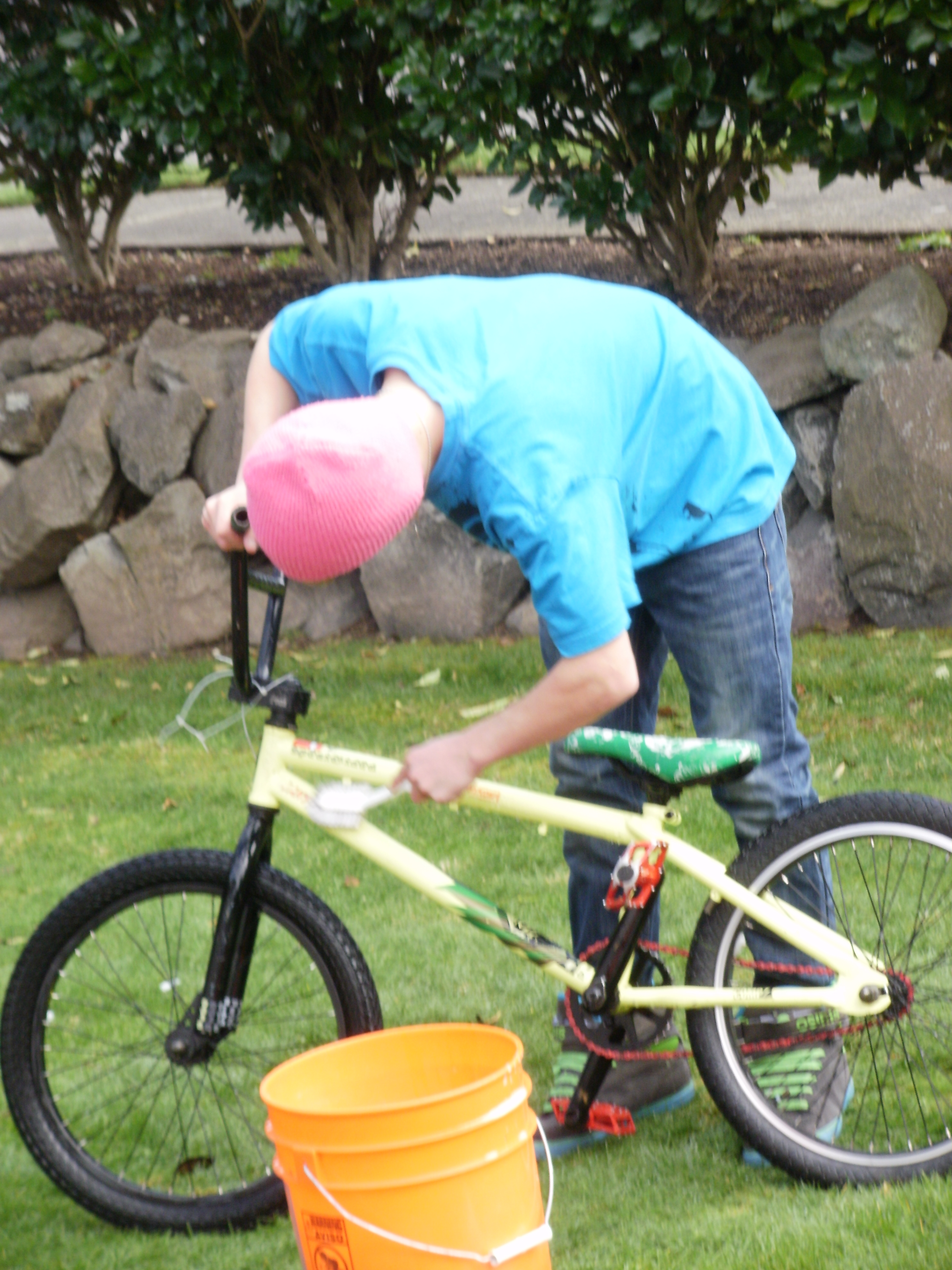 My kid washing his bike