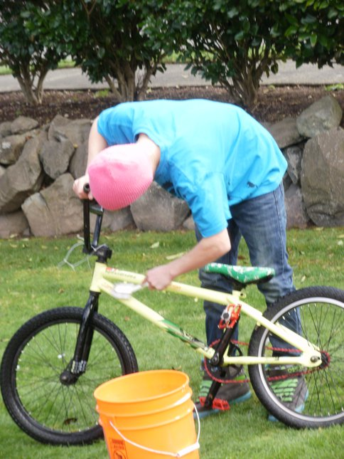 My kid washing his bike
