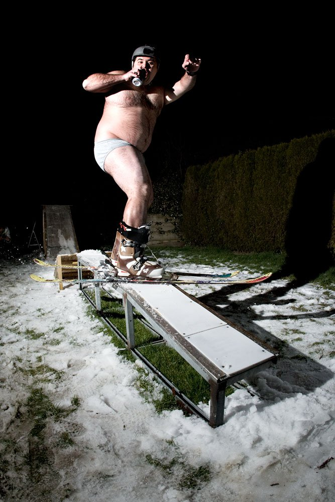 Ski + a lot of beers = Fat guy riding a rail naked!