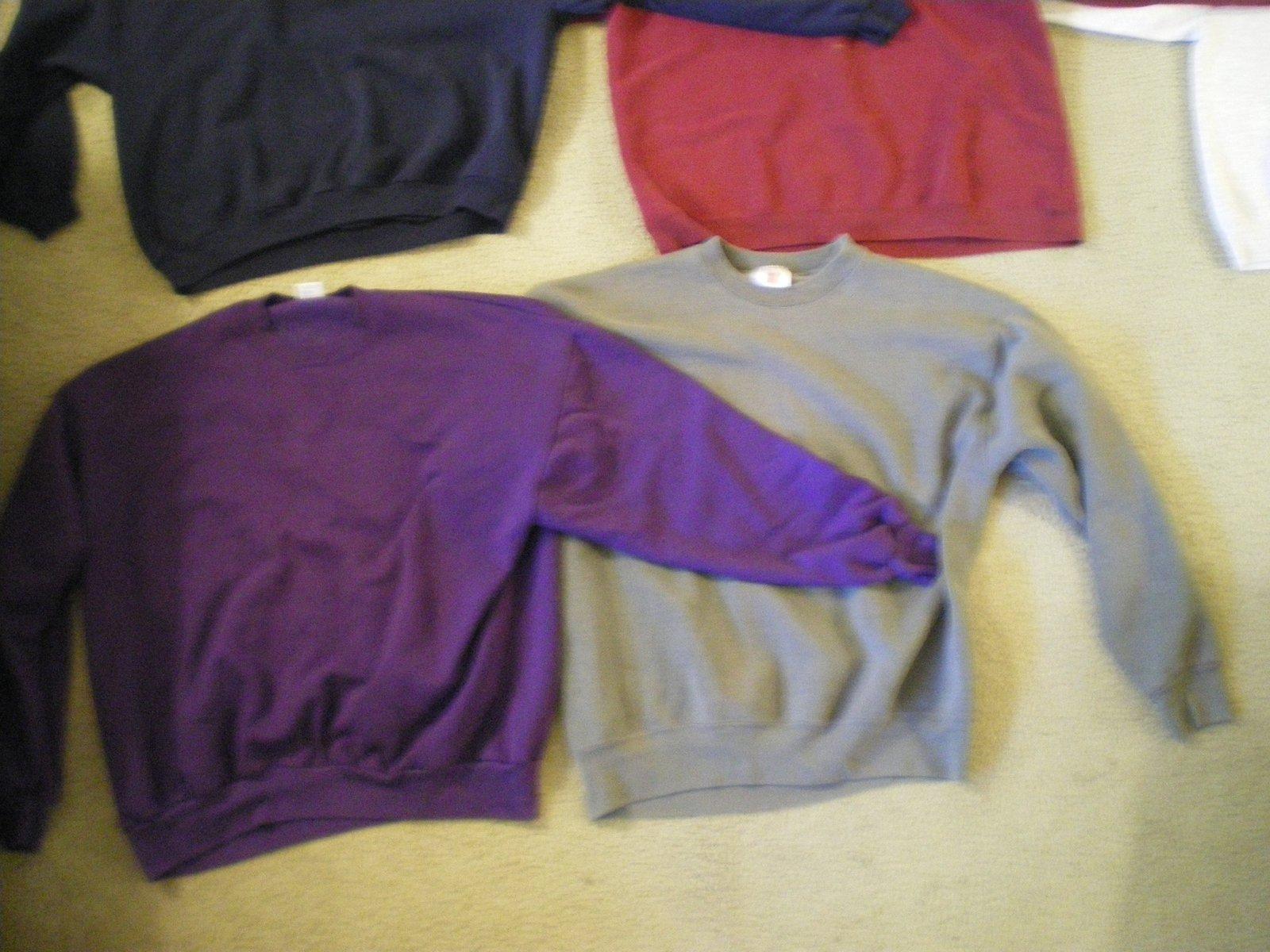 Purple and dark grey crewnecks