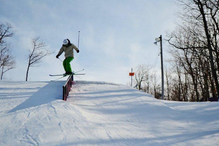 Crossed skis on the rail