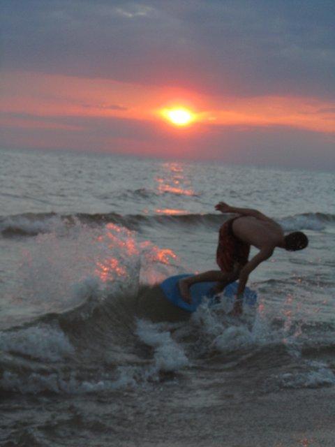 Skimboarding sunset