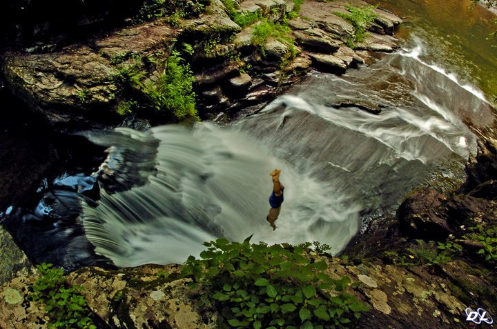 Diving Into a Small Waterfall Pool