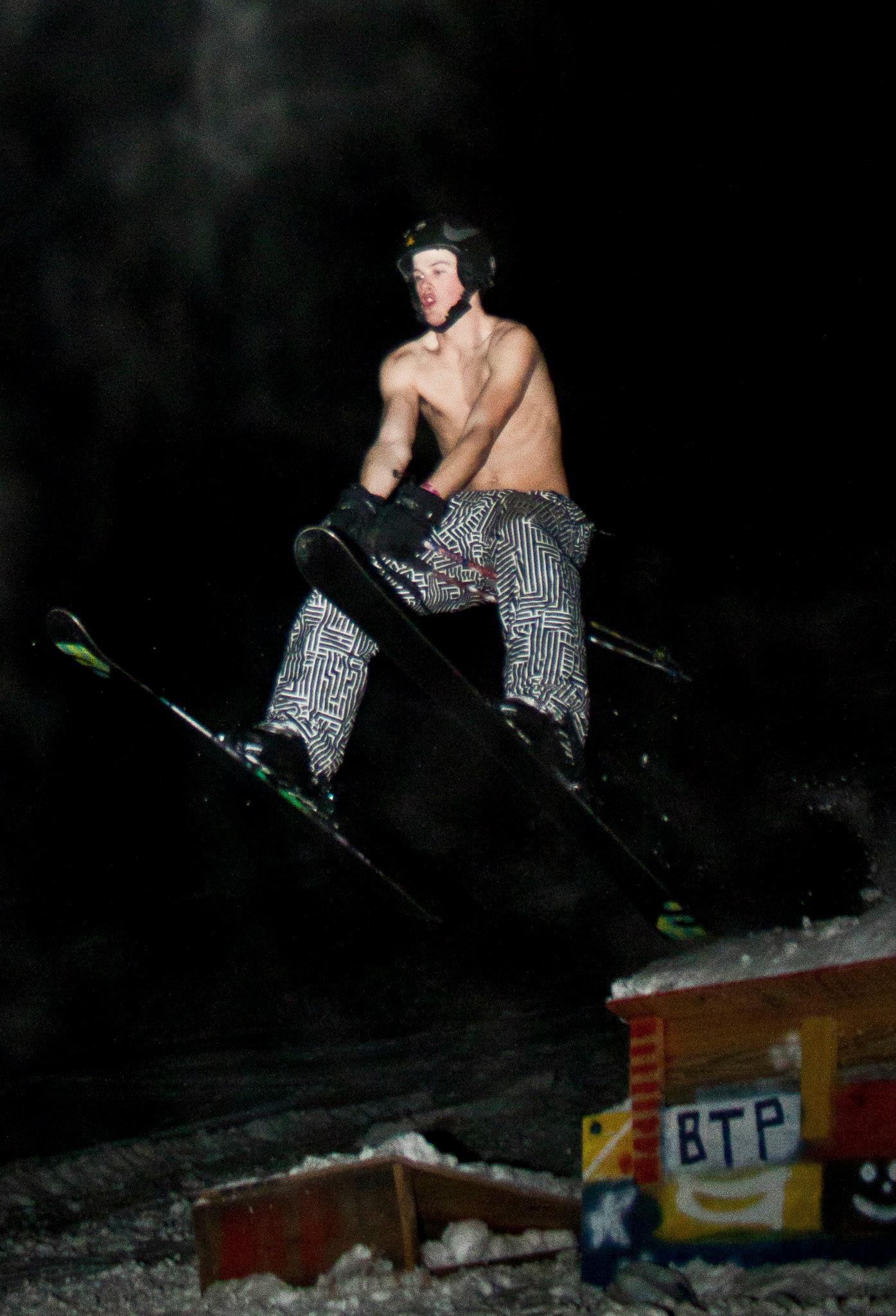 Bare chest night skiing