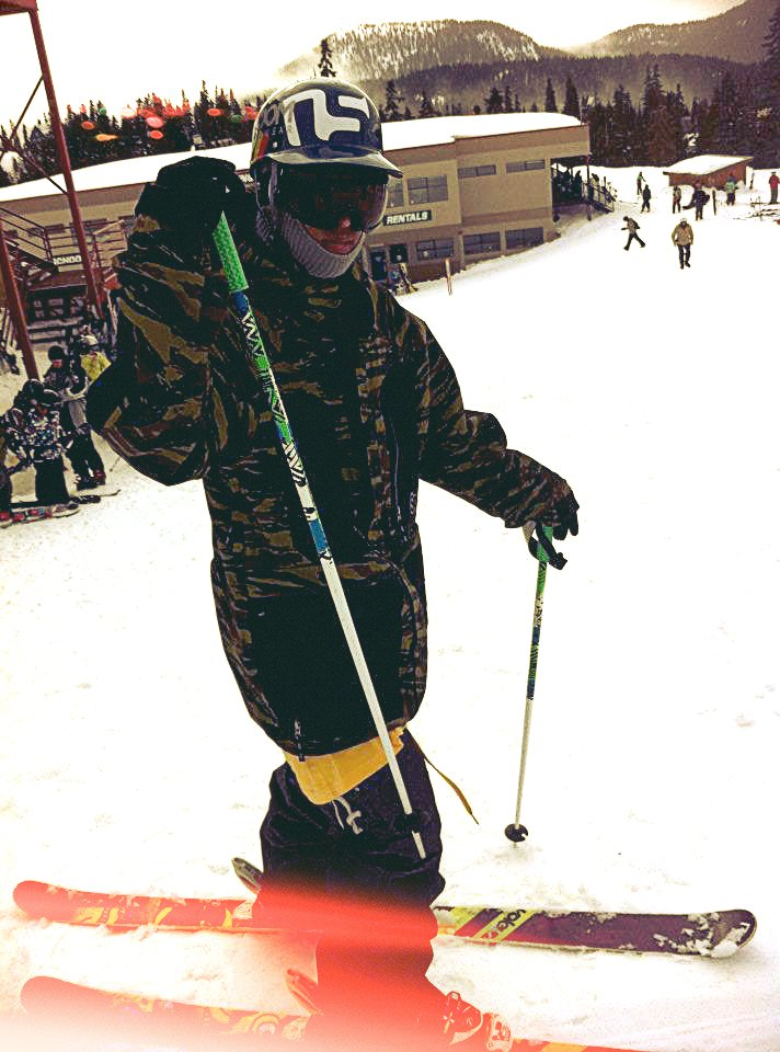 Snowboarder on skis