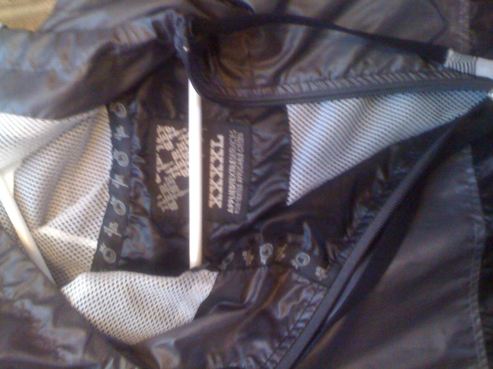 4x black and gray windbreaker