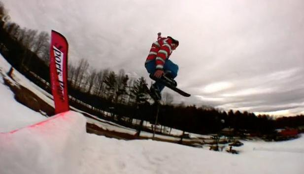 Huge tail grab over a massive spring photoshoot booter