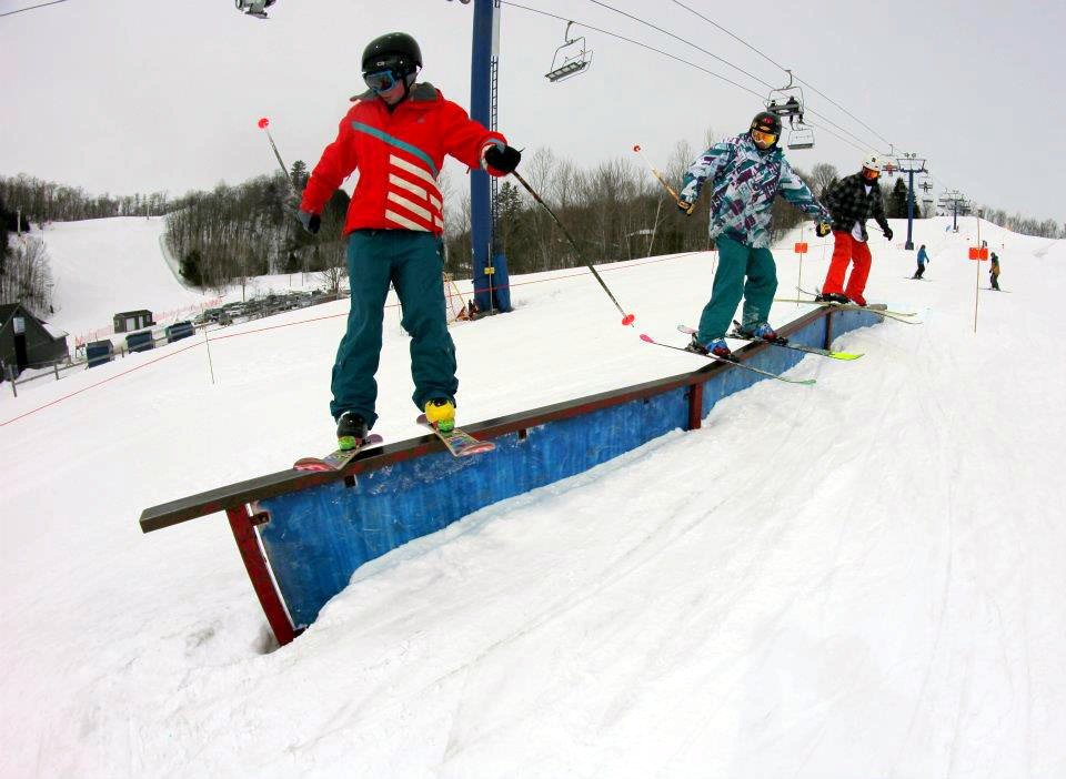 3 Skiers One Rail