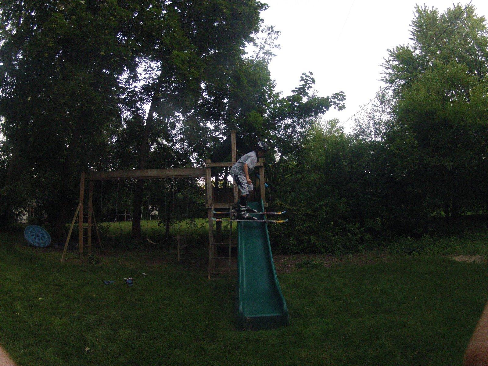 Backyard Skiing Down A Slide!