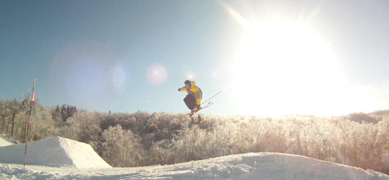 Waving hand near ski, solid grab