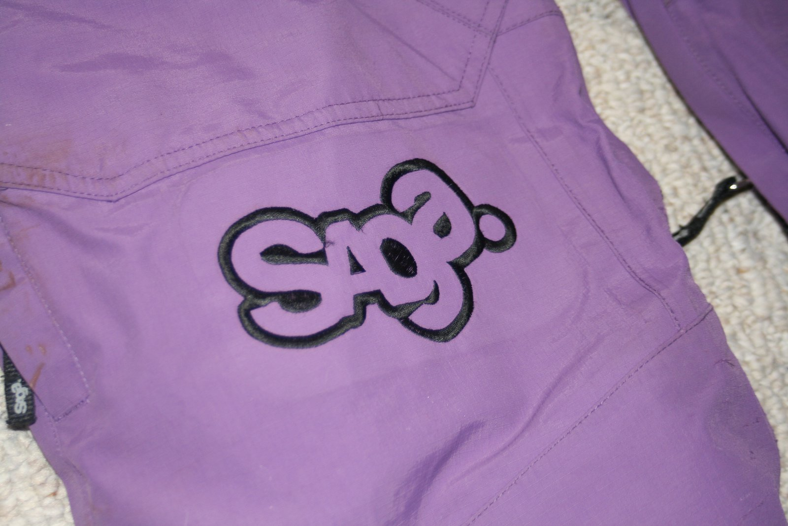 logo on SAGA pants