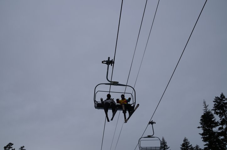 Alex Grover riding up the chairlift