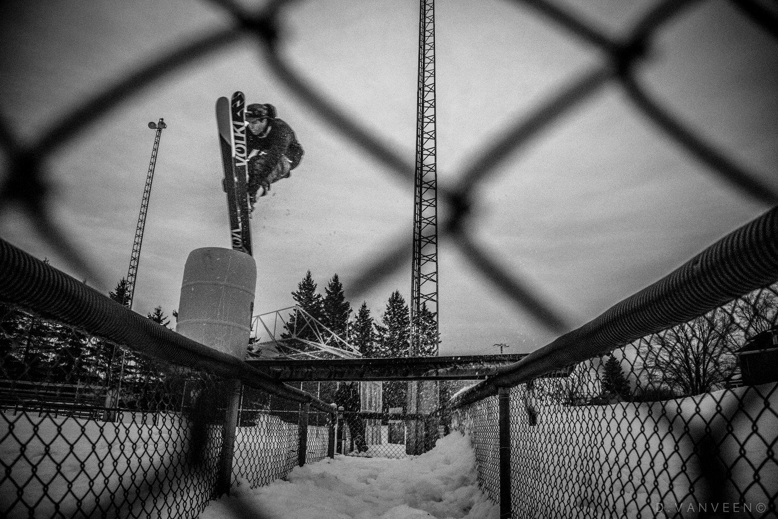 Through the fence.