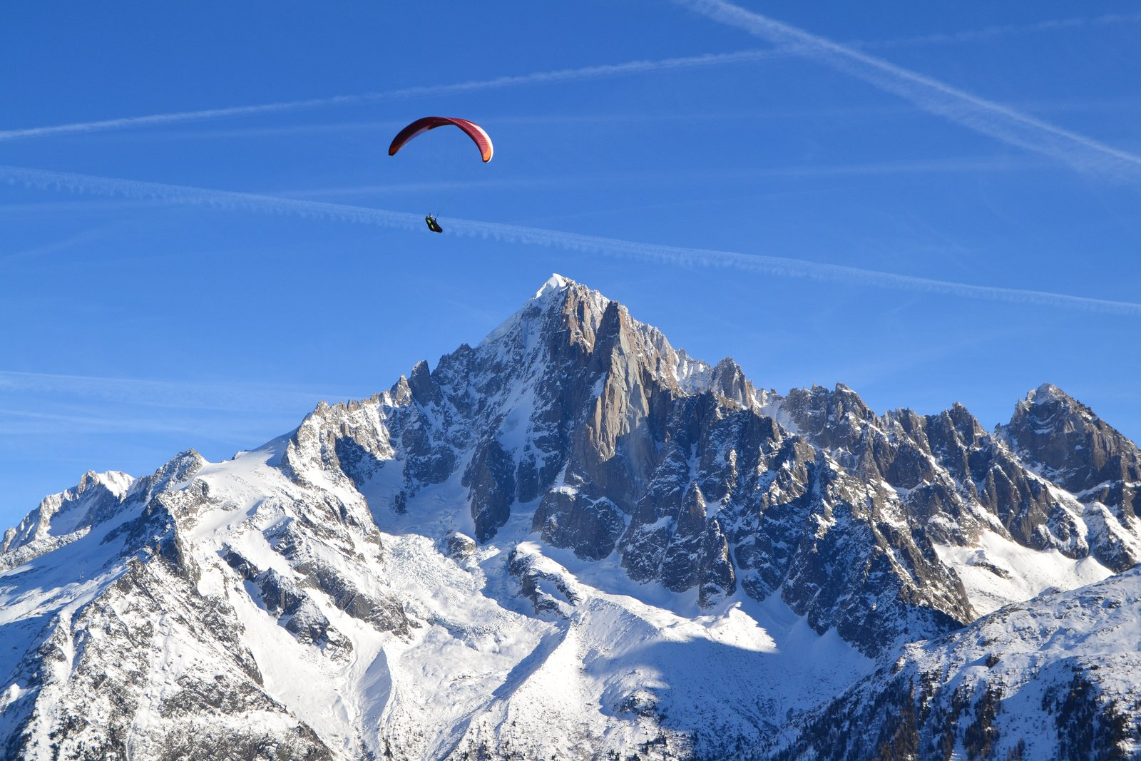 Paraglider soars high above the Chamonix valley