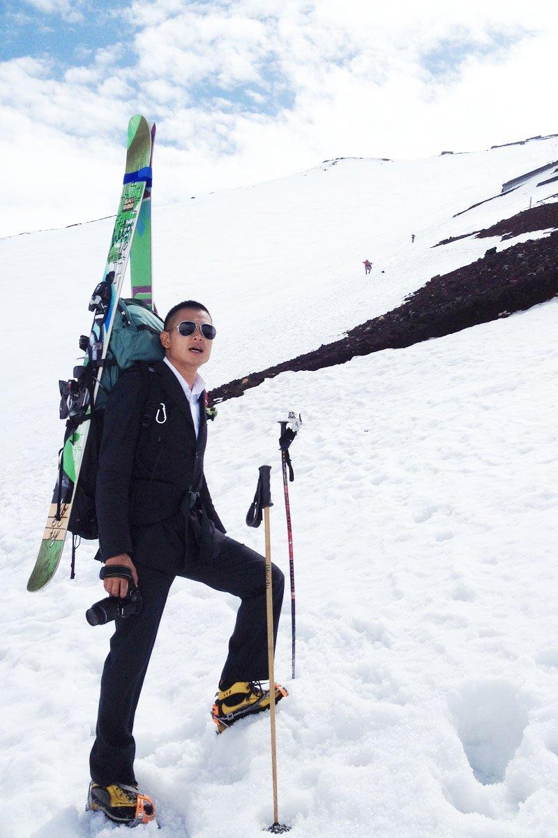 Suit guy in Top of winter Fujiyama