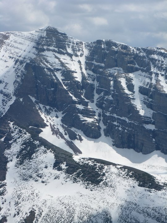 A waiting game: notching a spring first descent in Glacier National Park