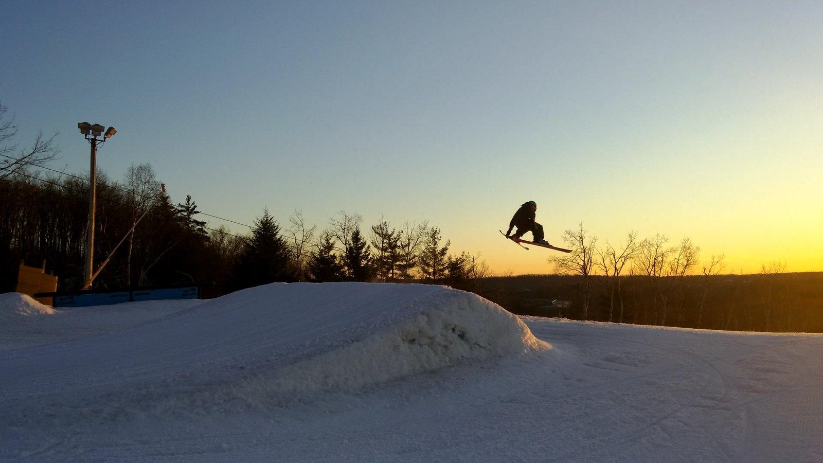 Skiing at sun set