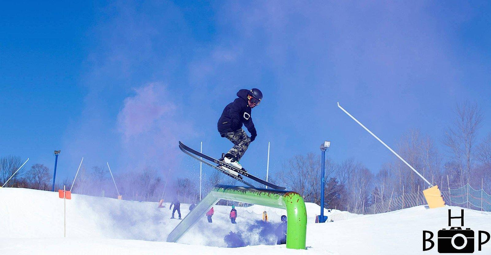 skiing on rail
